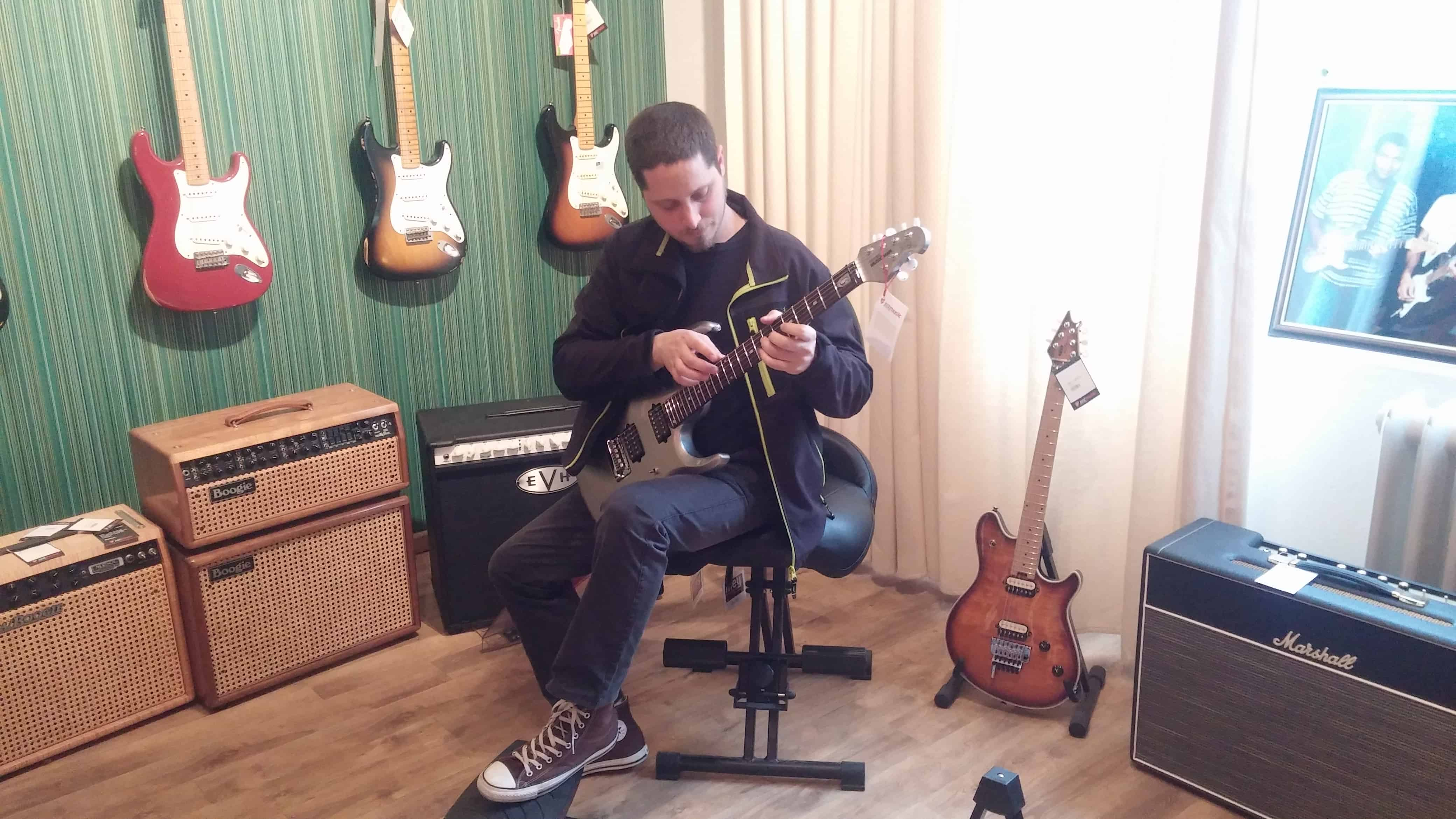 Yuval checking guitars at Just Music Berlin